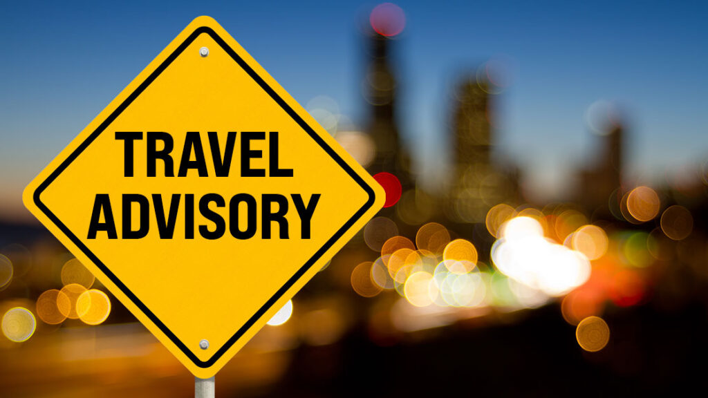image of yellow sign with words travel advisory. This links to a March 26, 20201 travel advisory from the NYC DOE